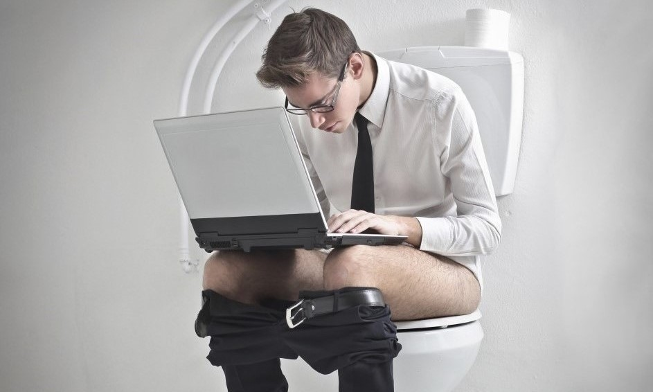 Man reading on toilet