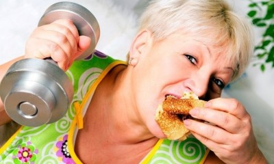 Woman eating and exercising
