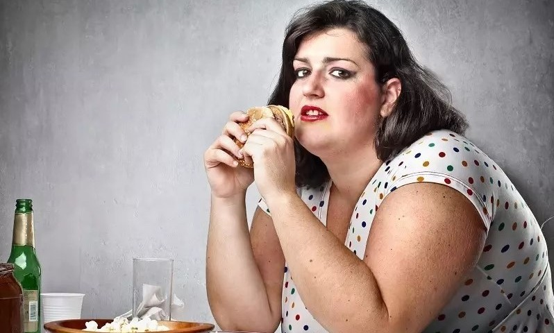 Overweight woman eating