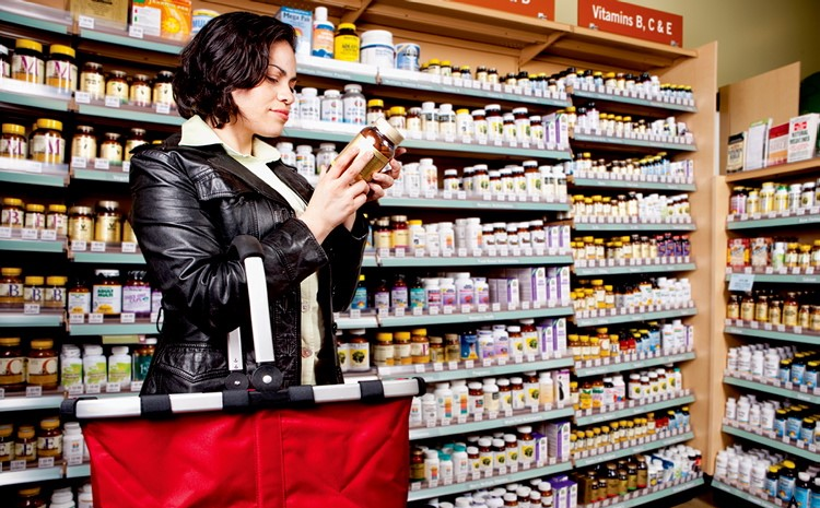 Woman Shopping Vitamin D Pills