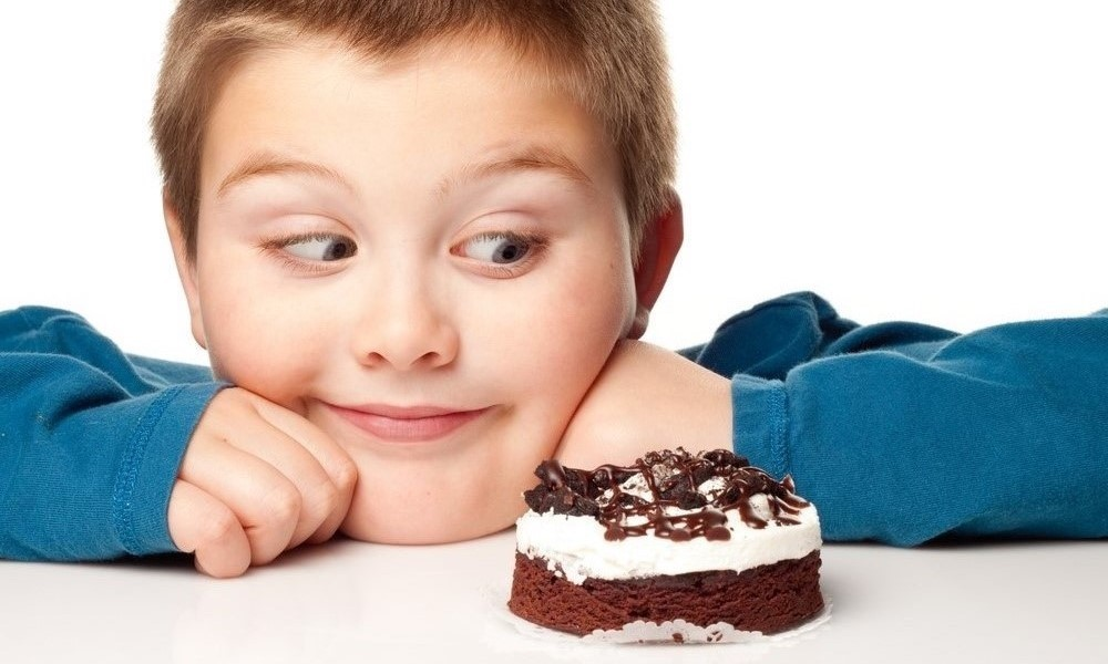 Kid with sweet food
